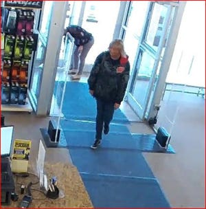 Surveillance video shows the alleged Rogan's Shoes store thief entering the store carrying a large bag.