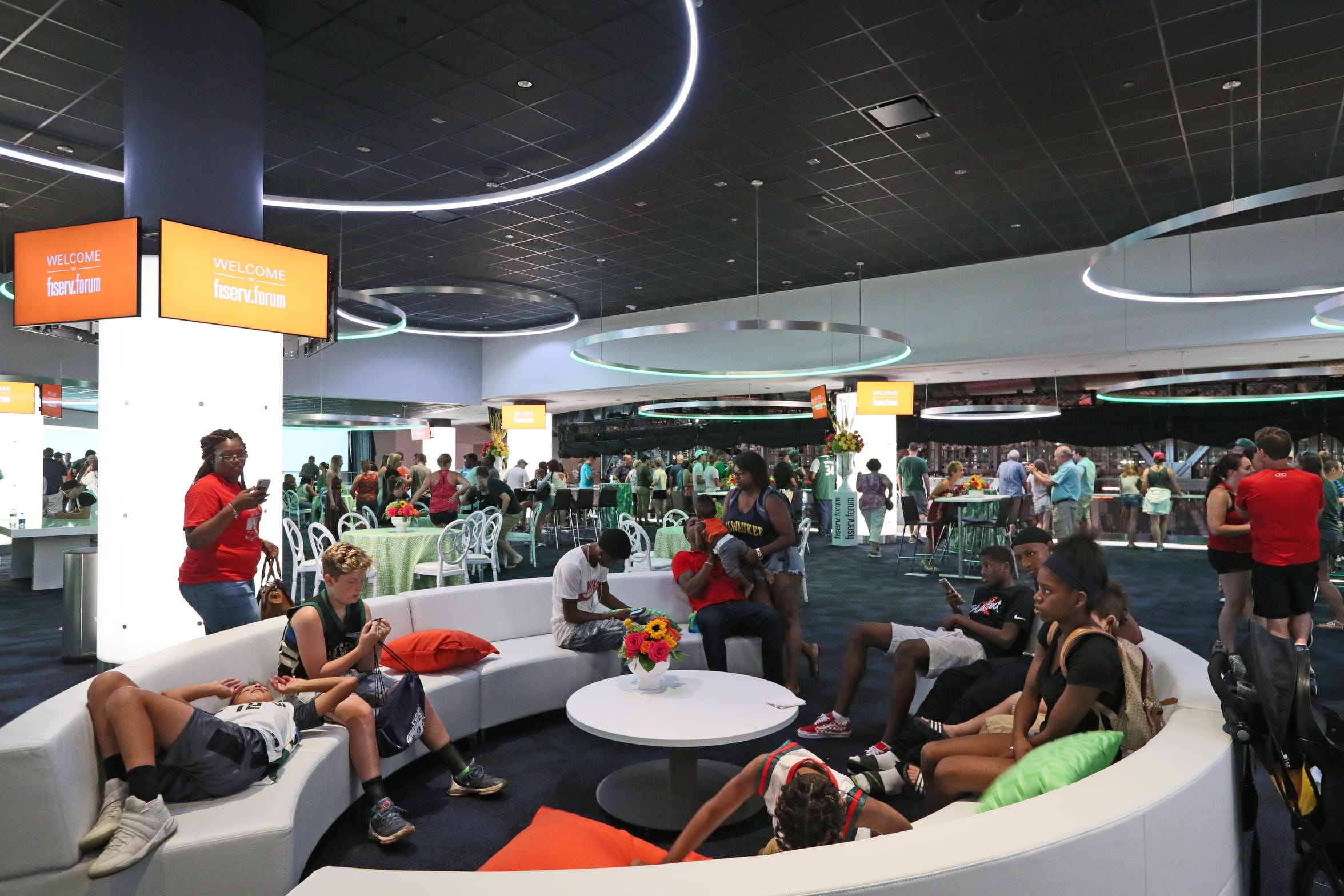 During the grand opening of Fiserv Forum on Aug. 26, visitors explore the Panorama Club level.