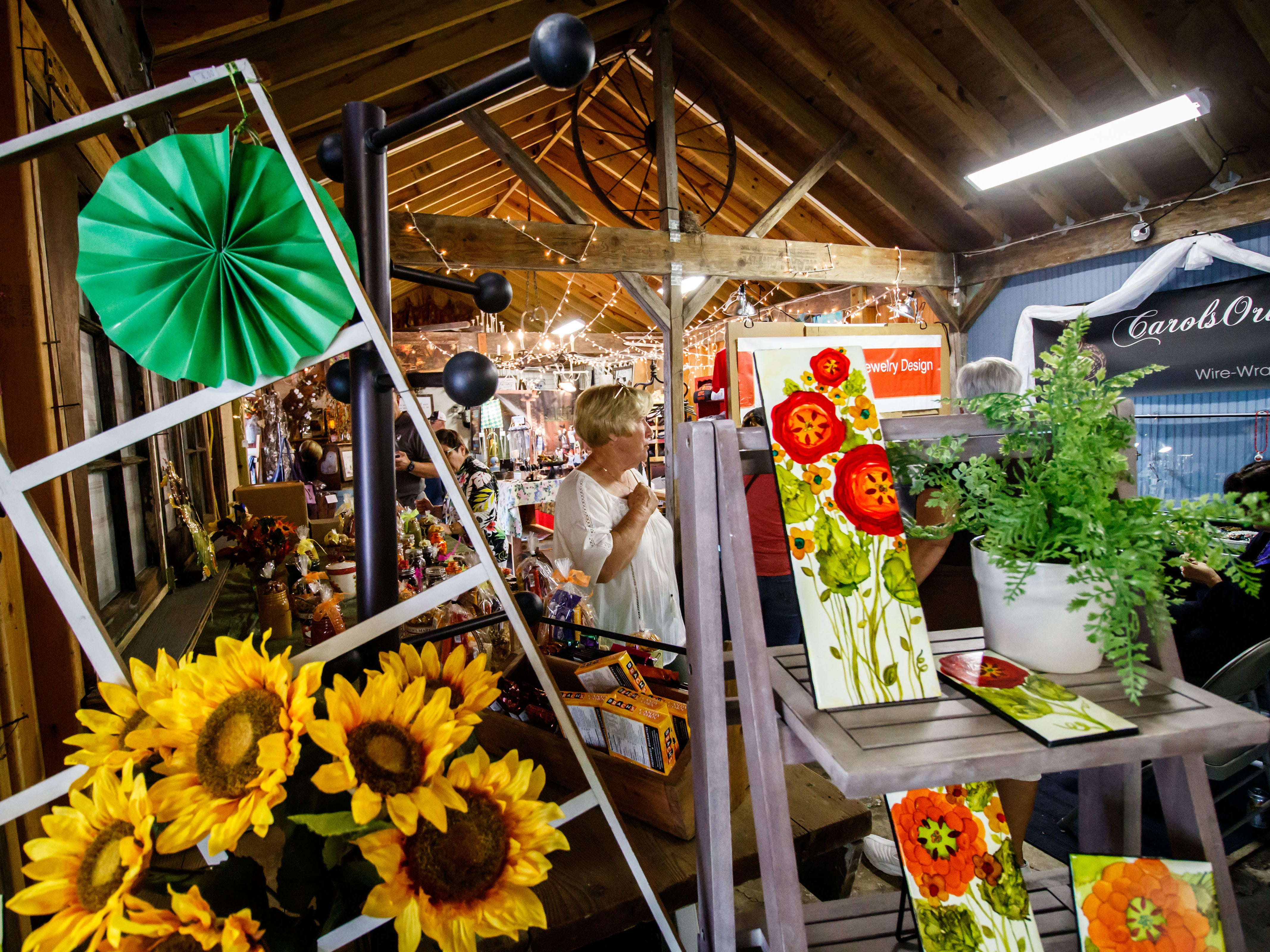 Customer shop for vintage, antique, upcycled, recycled and handmade treasures during Barn Market Weekend at Hawthorne Hill Farm in New Berlin on Friday, Sept. 7, 2018. The free three-day event features more than 50 local artisans and vendors.