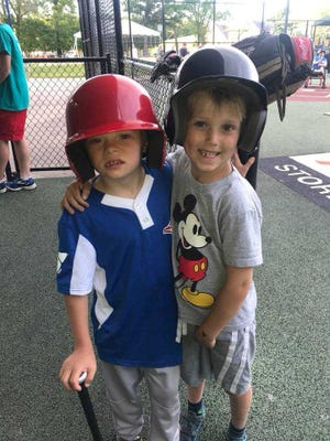 Through the YMCA's Miracle League of Milwaukee program, kids can volunteer to help out children with special needs play baseball.