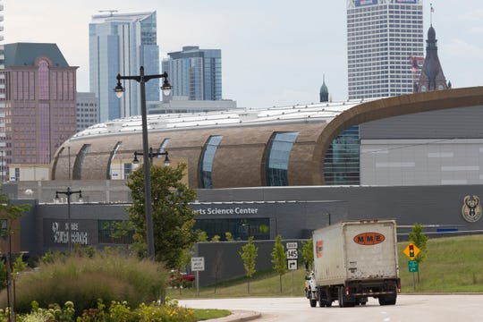 The newly constructed Fiserv Forum hosts a conference Wednesday night on race and the city's epidemic of neurological trauma.