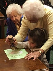 Kids and the elderly help each other in the intergenerational play group at Eastcastle Place.