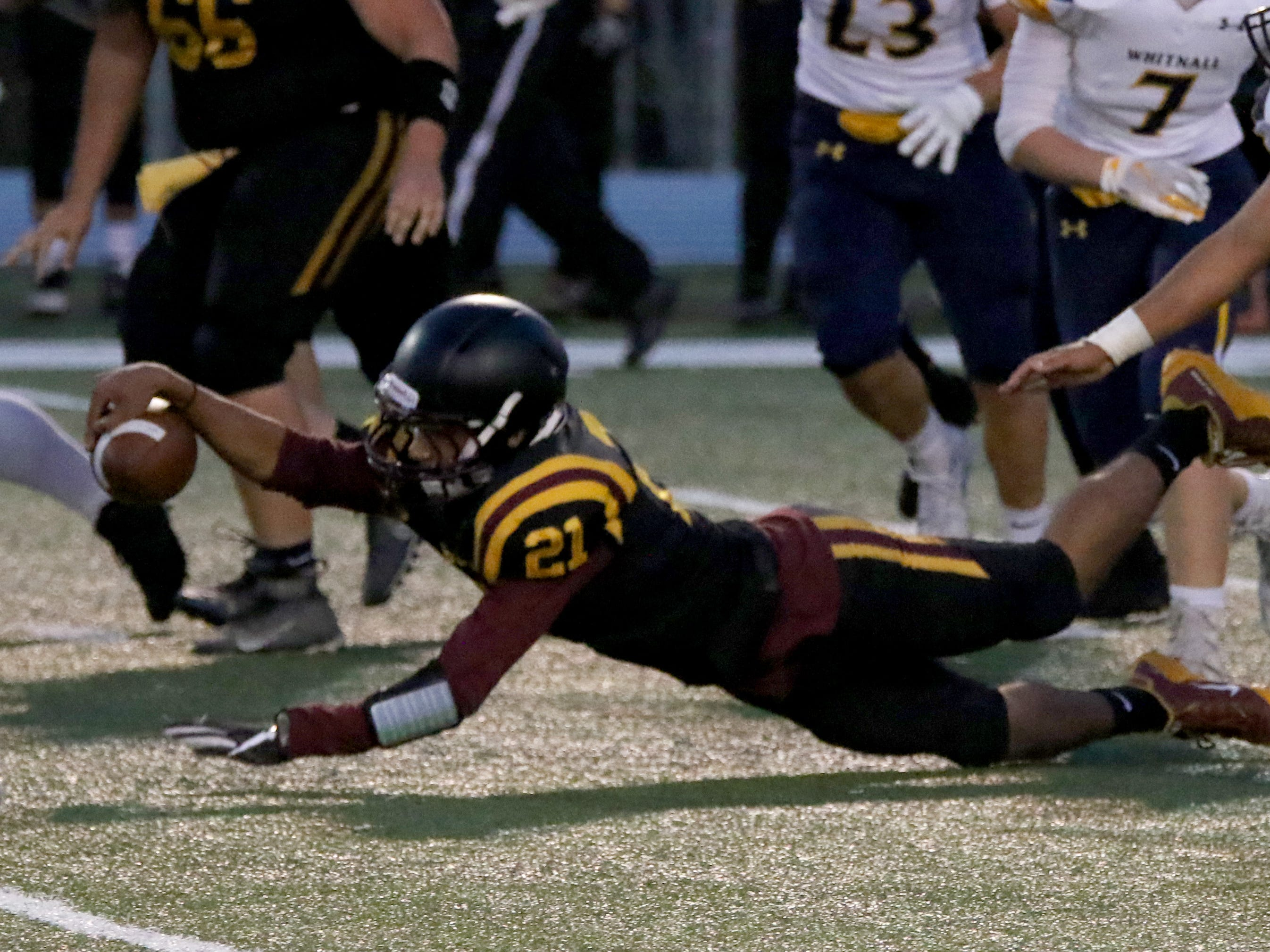 West Allis Central's Darius Grice stretches for extra yards against Whitnall at Central on Sept. 6.