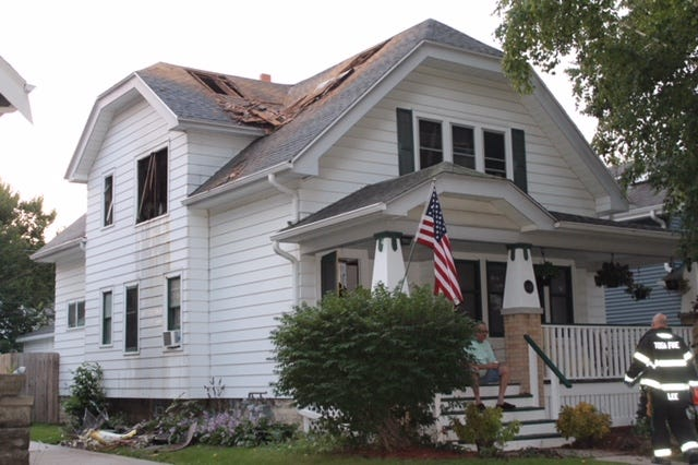 Holes in the roof and broken out windows are a testimony to an early morning blaze Friday, Sept. 7, on 70th Street in Wauwatosa.