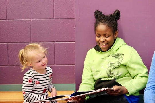 Younger children and older children work together as reading buddies at some Milwaukee Public Schools.