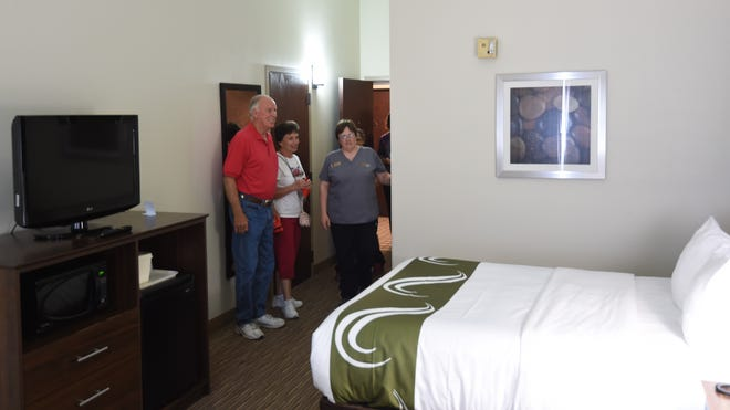 Room attendant Karen Guiley (far right) shows Richard and Rebecca Kemp of Mountain Home look over one of the renovated rooms at the Quality Inn and Suites Mountain Home on Thursday.