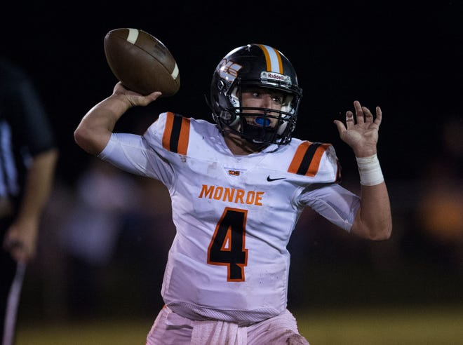 Monroe's Carter Ledkins (4) passes the ball against Success Unlimited Academy at True Divine Baptist Church in Montgomery, Ala., on Thursday, Sept. 6, 2018.