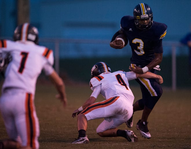 Success Unlimited's Jamari Smith (3) avoids a tackle by Monroe's Carter Ledkins (4) at True Divine Baptist Church in Montgomery, Ala., on Thursday, Sept. 6, 2018.