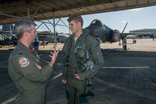 "Col. Ed Casey, vice wing commander at the 187th Fighter Wing, left, speaks with Capt. Richard ""Lancer"" Brennan flew an F-35, shown in background, to Montgomery on Friday, Sept. 7, 2018, at Dannelly Field in Montgomery, home of the Alabama Air National Guard's 187th Fighter Squadron."