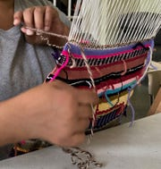 Kacie Lyn Martinez holds a weaving workshop at the Muncie YWCA.