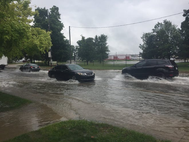 A portion of Wheeling Avenue is flooded on Sept. 7, 2018, after a bout of heavy rain.