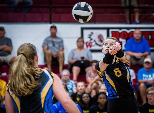 Burris setter Mara Perry keeps a ball alive against Wapahani at Wapahani High School Thursday, Sept. 6, 2018.