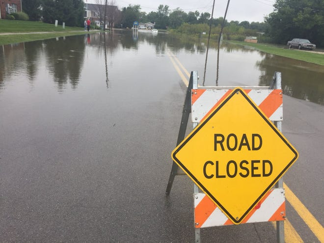 North Elgin Street by the Muncie Area Career Center is closed off for flooding on Sept. 7, 2018, after a bout of heavy rain.
