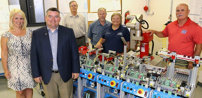 Pictured in the mechatronics lab at Warren County High School, from left, are Sally Pack, Motlow administrator of high school initiatives; John Marshall, Oakland High School principal; Fred Rascoe, Motlow dean of career and technical programs; Charlie King, Motlow mechatronics instructor; Melissa Paz, Motlow mechatronics instructor; and Jimmy Walker, Warren County High School principal.