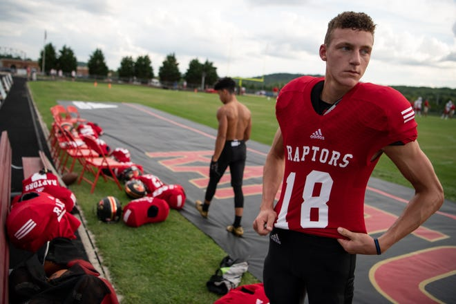 Ravenwood's Luke Akers (18) suits up before facing Page at Ravenwood High School in Brentwood, Tenn., Friday, Sept. 7, 2018.