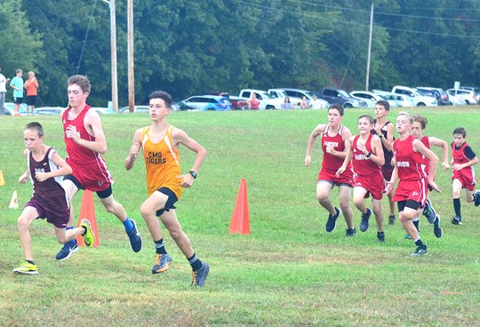 Members of the Fairview Middle Boys Cross Country Team out front at the start of the Buckner Park meet August 28, 2018.