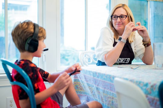 Shannon Ward chats with her son Bennett, 9, after dinner at their home in Franklin on Sept. 6, 2018. The family recently completed a two-month technology blackout with hopes of reconnecting as a family.
