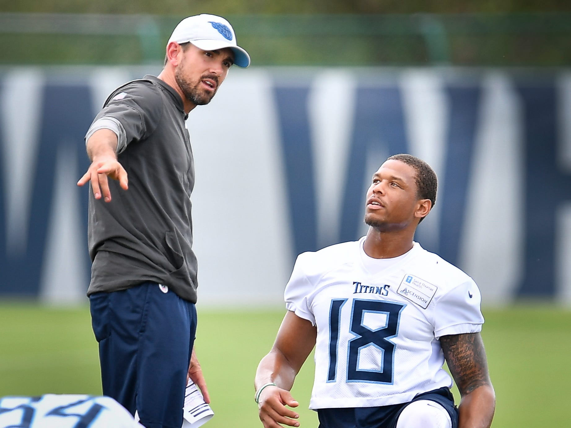 Tennessee Titans wide receiver Rishard Matthews (18) talks with offensive coordinator Matt LaFleur as he warms up before practice at Saint Thomas Sports Park Friday, Sept. 7, 2018, in Nashville, Tenn.