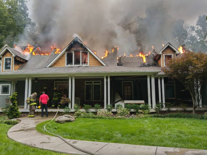 About 50 volunteer firefighters from different departments helped fight a large house fire in Portland off Ab Wade Road.