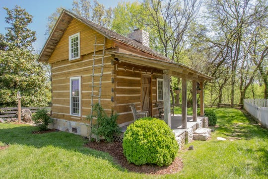 The property includes a log cabin.