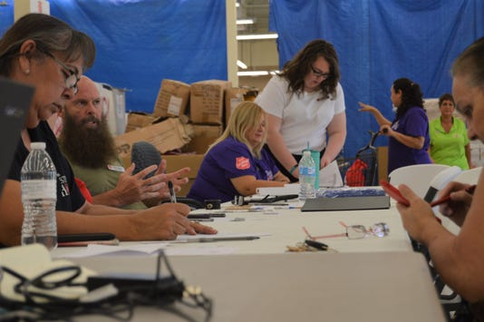 Staff works with individuals at the repair fair Friday