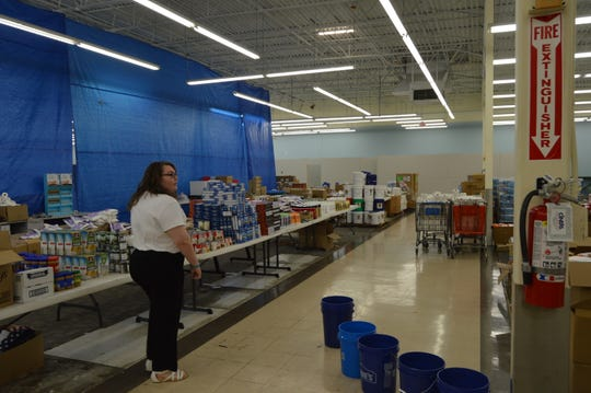 AnnaMarijka Tilleman, Lead Long-Term Recovery Coordinator with Salvation Army, walks through the warehouse at the Disaster Assistance Center Friday. The repair fair held Friday was meant to be a way for individuals to reach out for assistance.