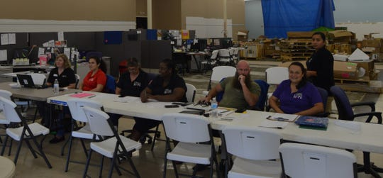 Workers at the Naples Salvation Army Disaster Assistance Center await individuals who may come in for assistance at the repair fair Friday. The repair fair was an effort to raise awareness of Salvation Army as an ongoing resource for victims of Hurricane Irma.