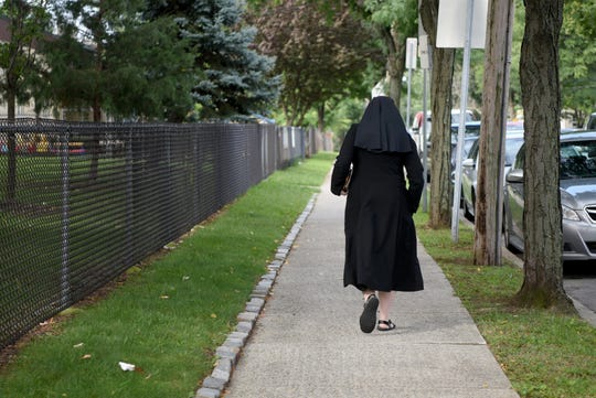 A nun leaves Sacred Heart Church in Clifton after the Latin mass on Sept. 2.