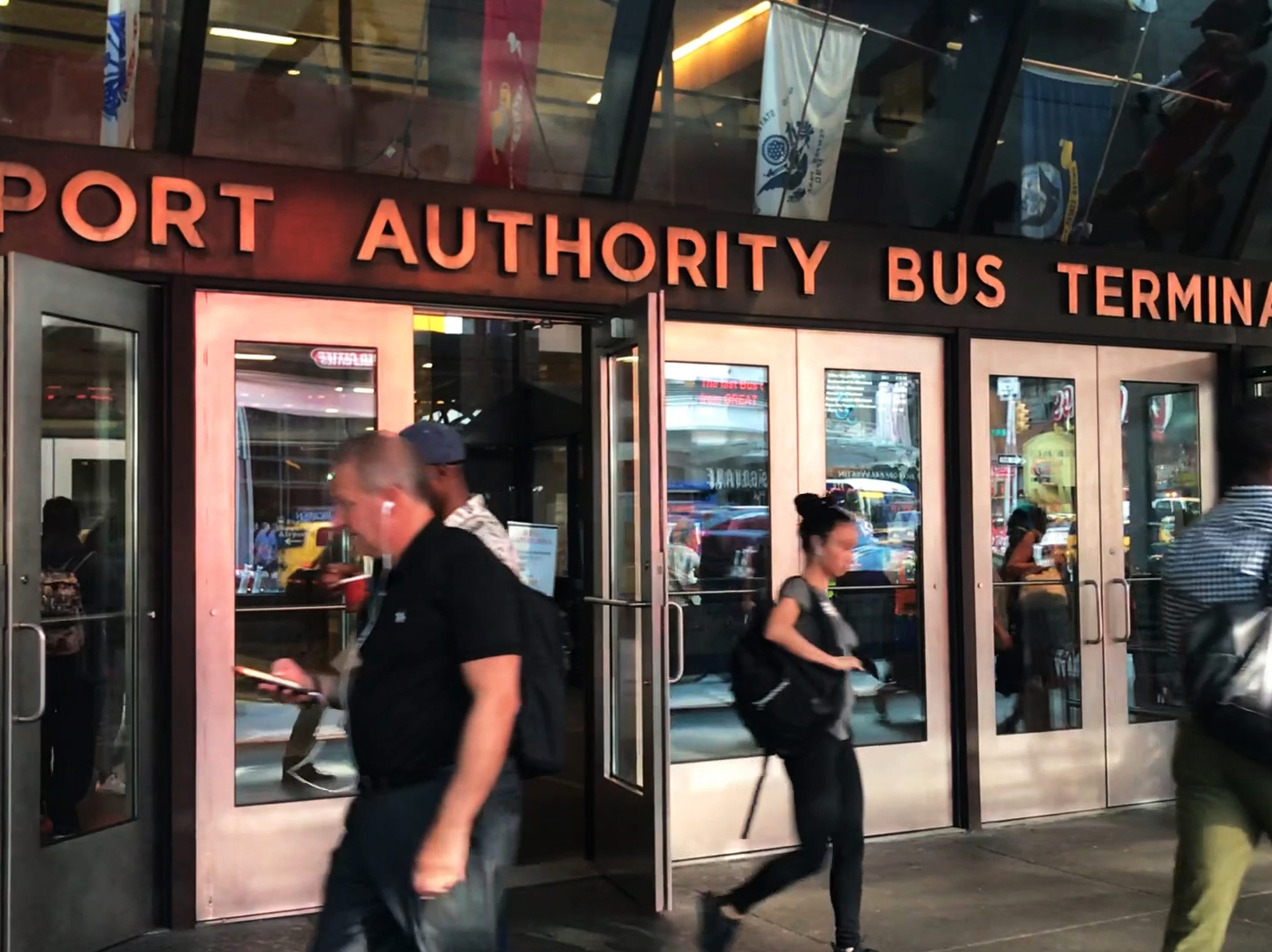 Commuters pass through the entrance of the Port Authority Bus Terminal in Manhattan on Tuesday September 4, 2018.