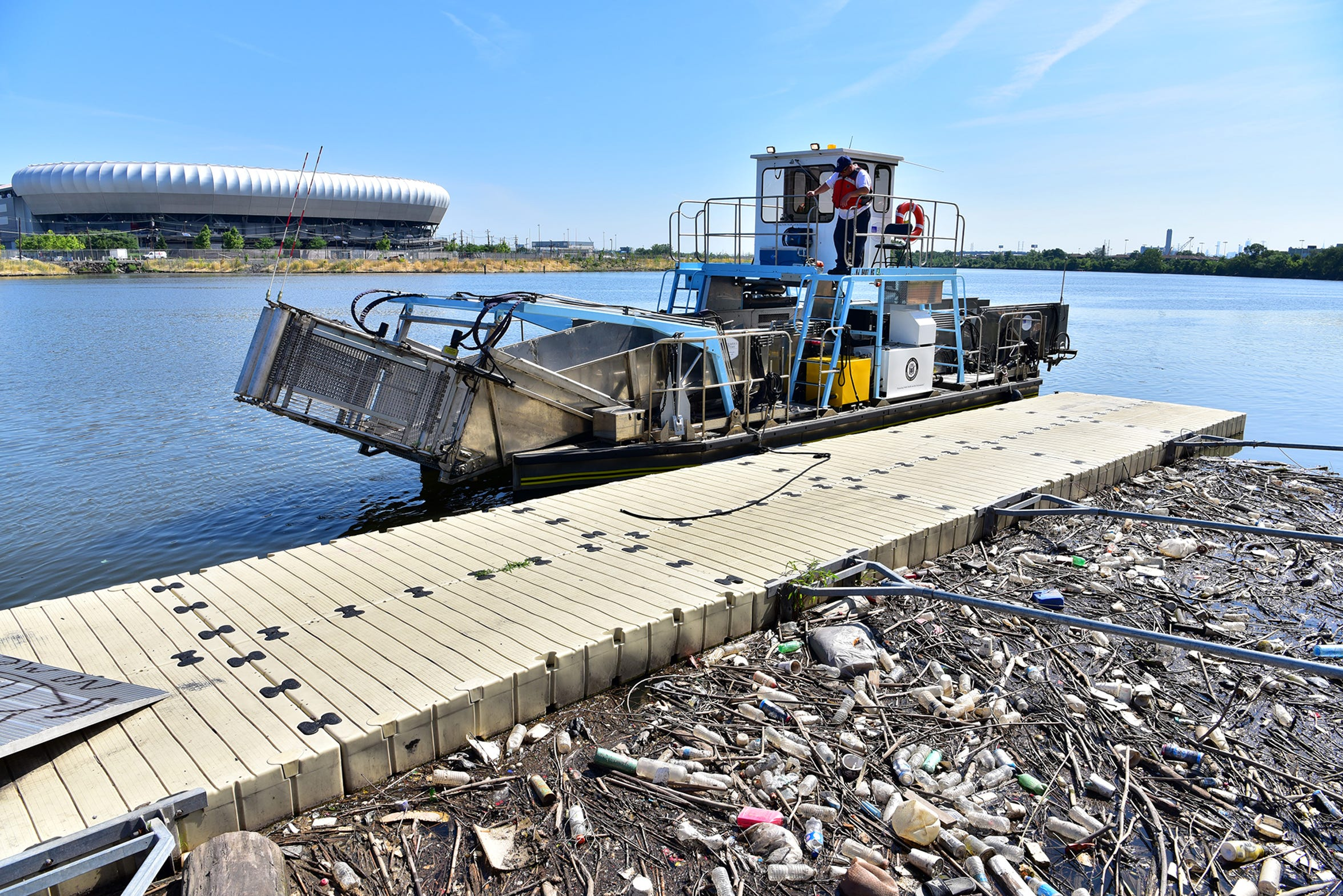 the Passaic Valley Sewerage Commission skimmer boat as they sweep garbage from the surface of the Passaic River