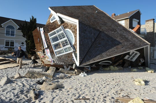 Ortley Beach, Toms River --- Thursday November 29, 2012 --- Assemblyman Scott Rumana R district 40, L-R, takes in the devastation left by Superstorm Sandy at a friends home in Normandy Beach.