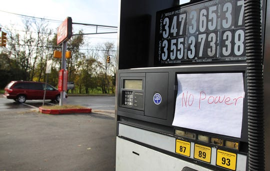A car passes a Getty gas station at the corner of River Road and Washington Avenue in Hawthorne on Nov. 1, 2012. The station had no power in the aftermath of Superstorm Sandy.
