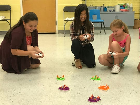 Students watched as multi-colored drones scooted across the classroom floor inside Harrington Park Public School during one Friday afternoon of summer camp.