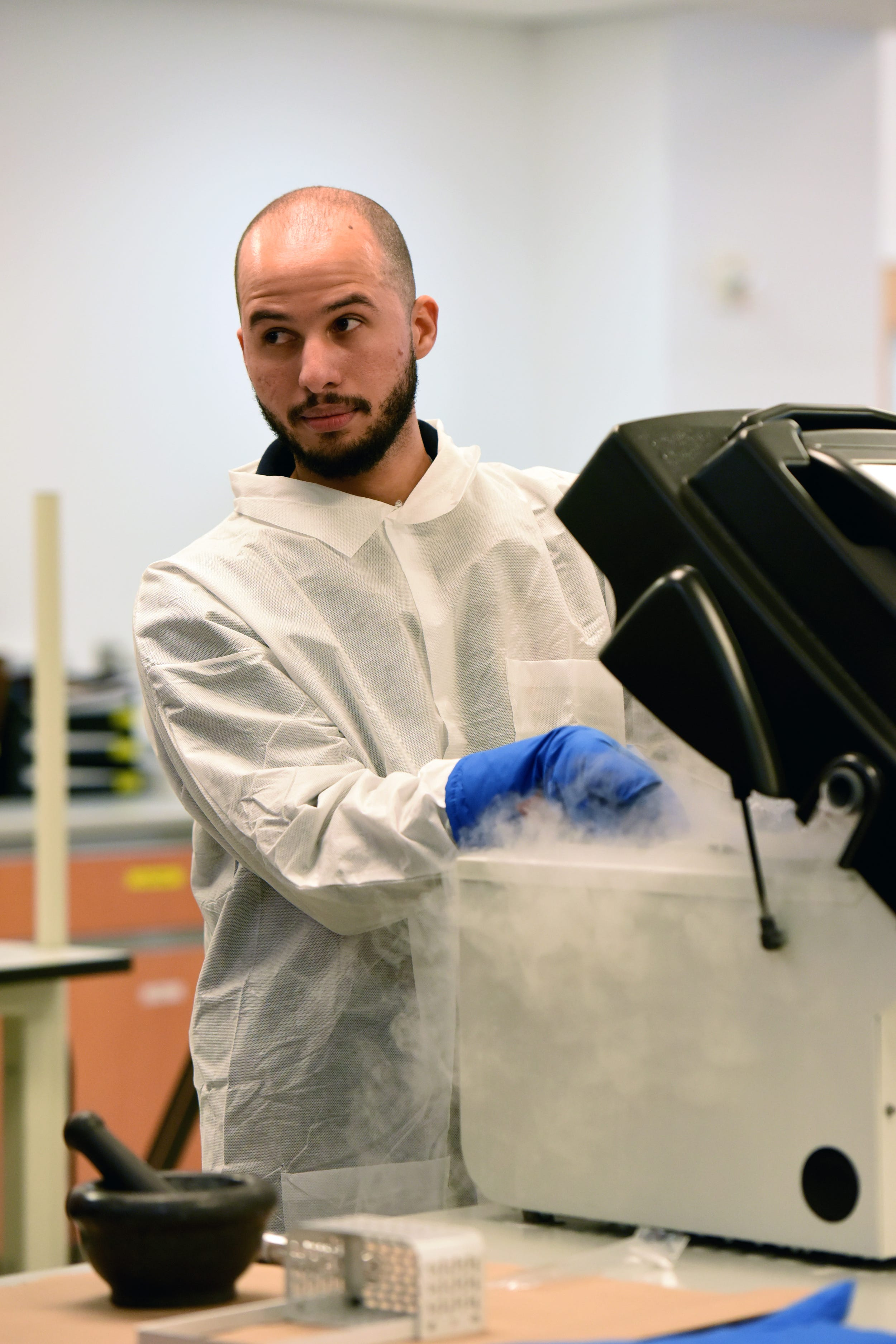 Yasser Hernandez, a forensic scientist with the New York City Office of Chief Medical Examiner, discusses the bone grinding process used to help identify remains of deceased victims. The unit handles DNA testing for unidentified persons, including victims of the attacks on the World Trade Center on 9/11.