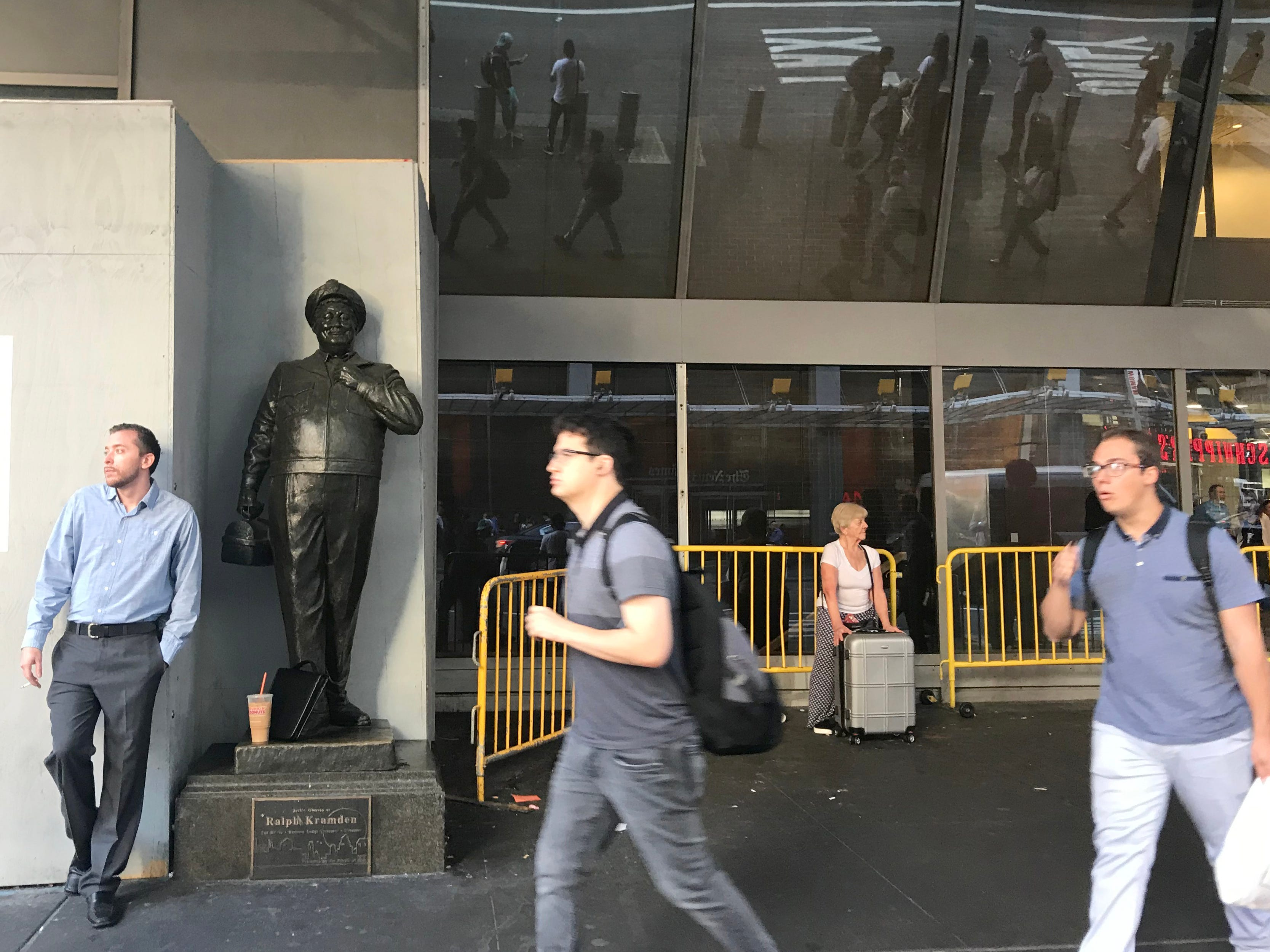Commuters pass by the entrance of the Port Authority Bus Terminal in Manhattan on Tuesday September 4, 2018.