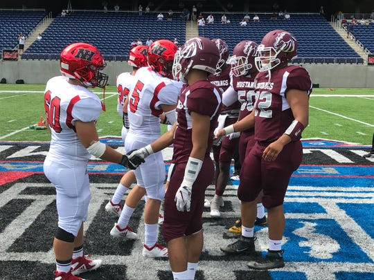 From 2018: Clifton and Northern Highlands captains shake hands at midfield before the coin toss at Tom Benson Hall of Fame Stadium.