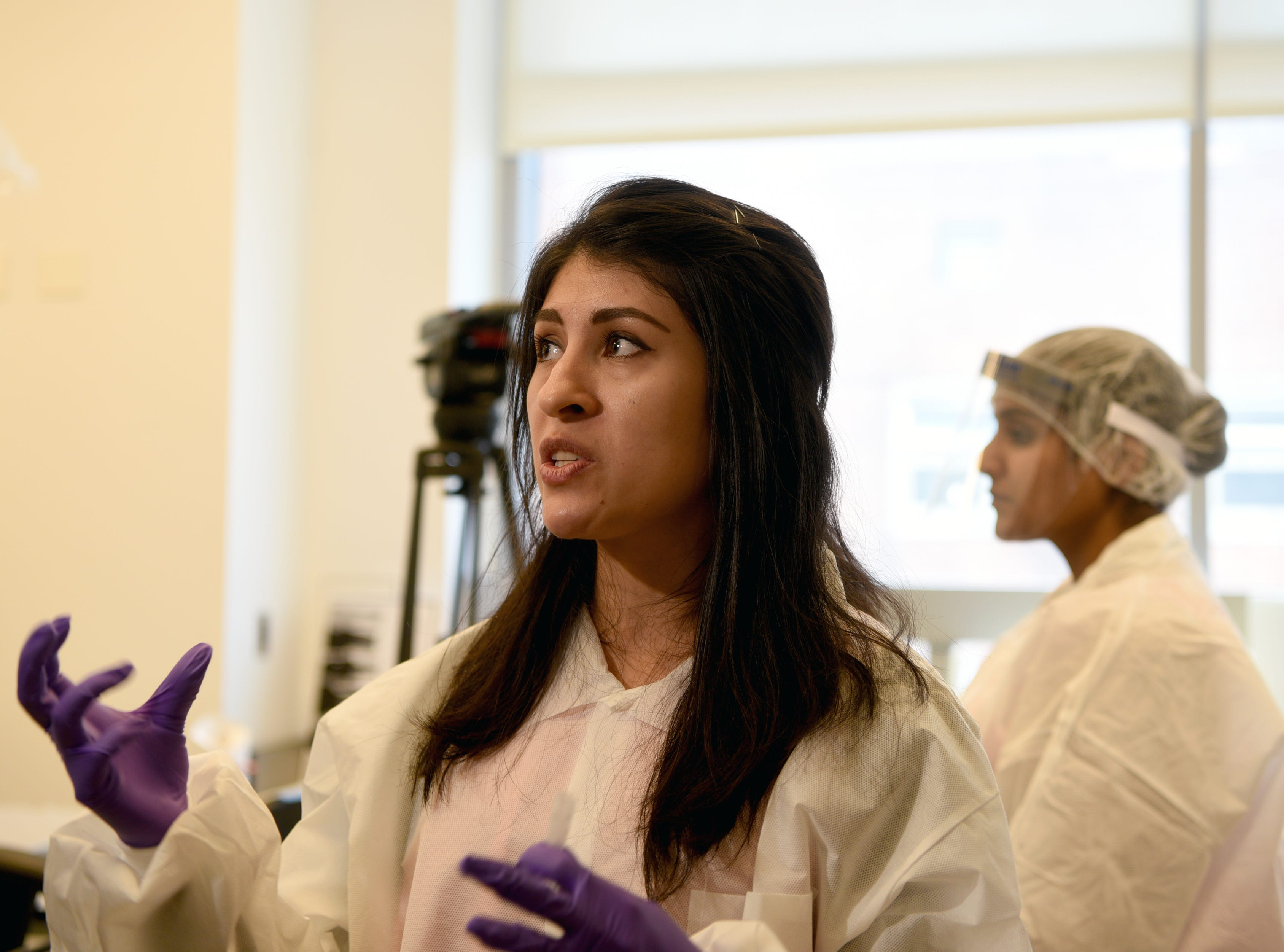 Veronica Cano, a criminalist with the New York City Office of Chief Medical Examiner, explains the process used to isolate and purify DNA in helping to identify remains of deceased victims. The unit handles DNA testing for unidentified persons, including victims of the attacks on the World Trade Center on 9/11.