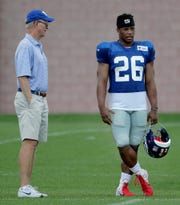 New York Giants co-owner and team president John Mara, left, talks to running back Saquon Barkley during NFL football training camp, Thursday, Aug. 2, 2018, in East Rutherford, N.J.