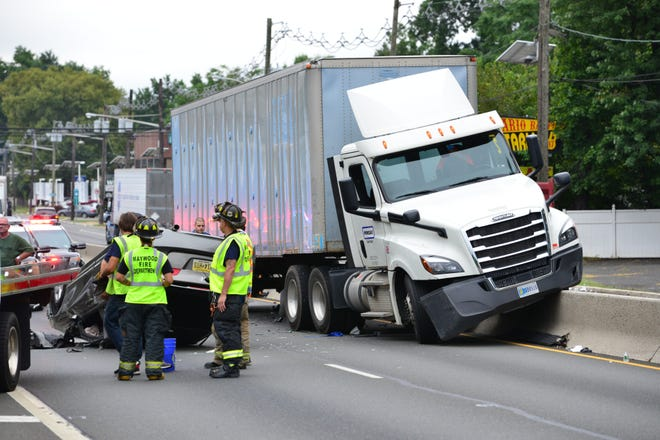 Emergency personnel on the scene of a tractor trailer and Honda Civic accident that sent four people to the hospital with injuries on Route 17 northbound just before the Passaic St Exit around 9:05 in Rochelle Park on Friday morning September 7, 2018.