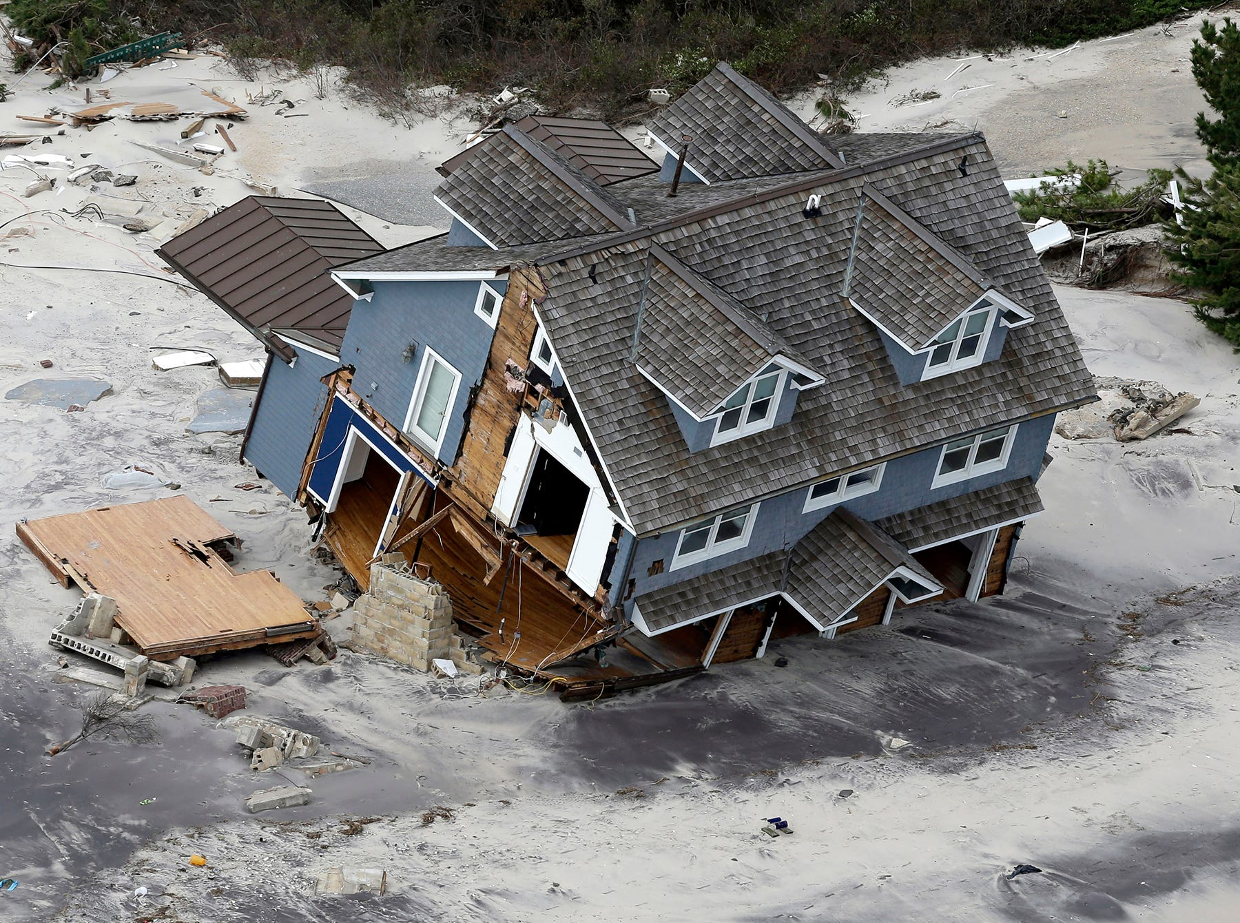 This aerial photo shows a collapsed house along the central Jersey Shore coast on Wednesday, Oct. 31, 2012. New Jersey got the brunt of Sandy, which made landfall in the state and killed six people. More than 2 million customers were without power as of Wednesday afternoon, down from a peak of 2.7 million.