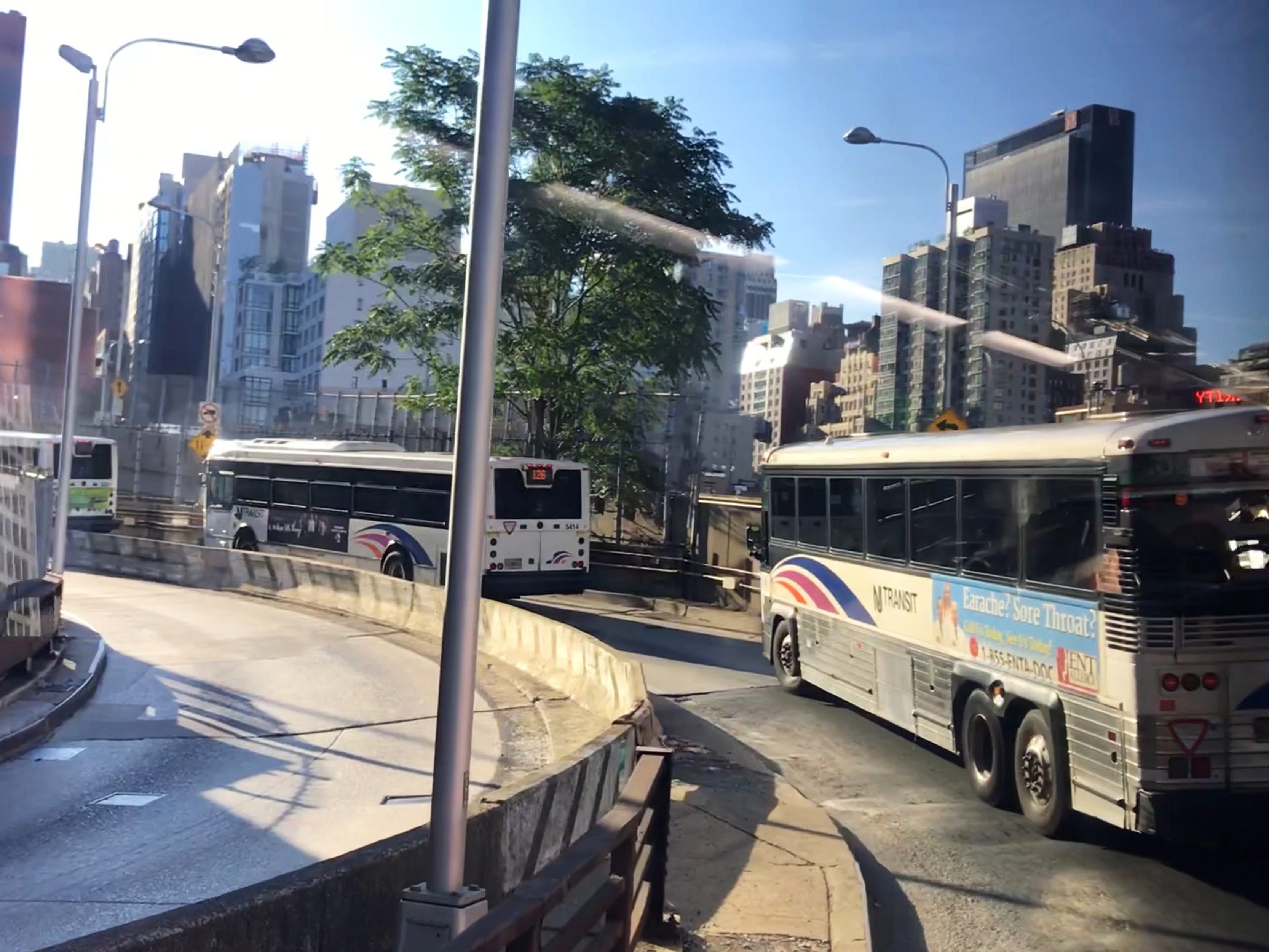 NJ Transit Buses make their way up the ramp to the Port Authority Bus Terminal after exiting the Lincoln Tunnel on Tuesday September 4, 2018.