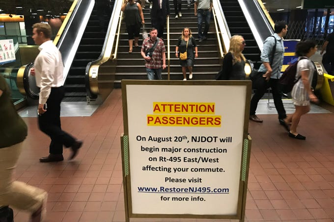 A sign posted in the Port Authority Bus Terminal warns passengers of the Route 495 construction project.