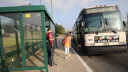 Independent Shuttle Buses Jitneys Or New Jersey Transit Buses Pick Up Commuters From Stops Along Route 4 For The Morning Commute Into Manhattan