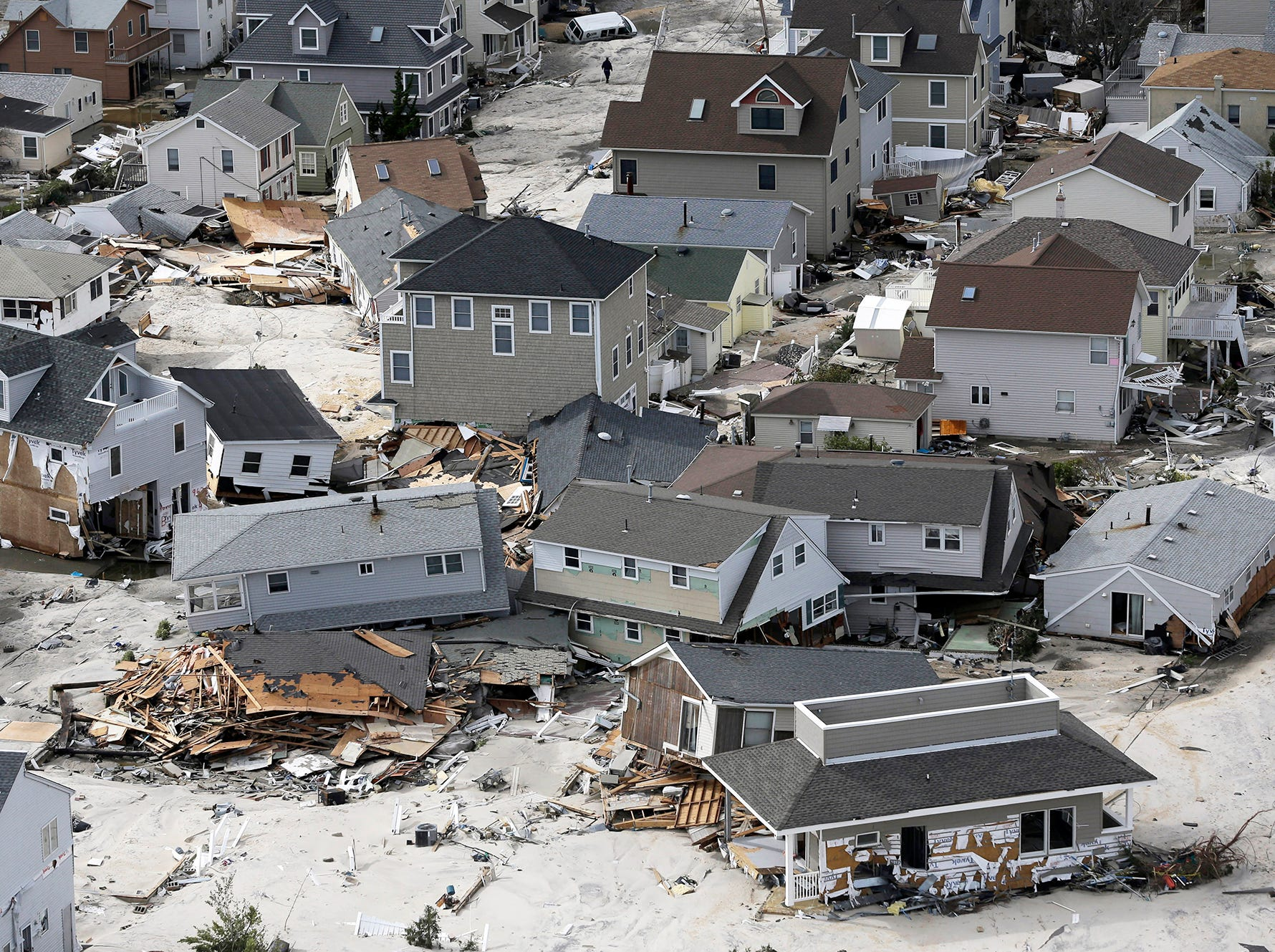 This aerial photo shows destroyed homes left in the wake of superstorm Sandy on Wednesday, Oct. 31, 2012, in Seaside Heights, N.J. New Jersey got the brunt of Sandy, which made landfall in the state and killed six people. More than 2 million customers were without power as of Wednesday afternoon, down from a peak of 2.7 million. (AP Photo/Mike Groll)