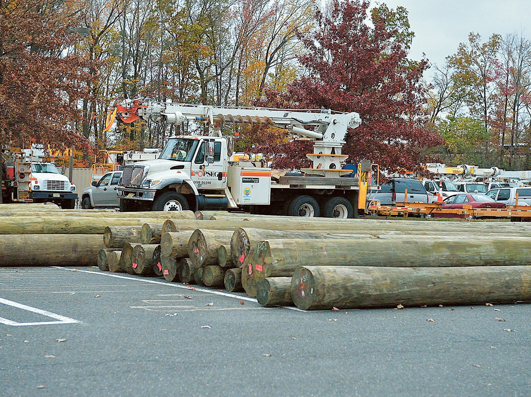 At the Garden State Plaza in Paramus, PSE&G crews and utility trucks gather at a staging area in anticipation of damage caused by Hurricane Sandy.