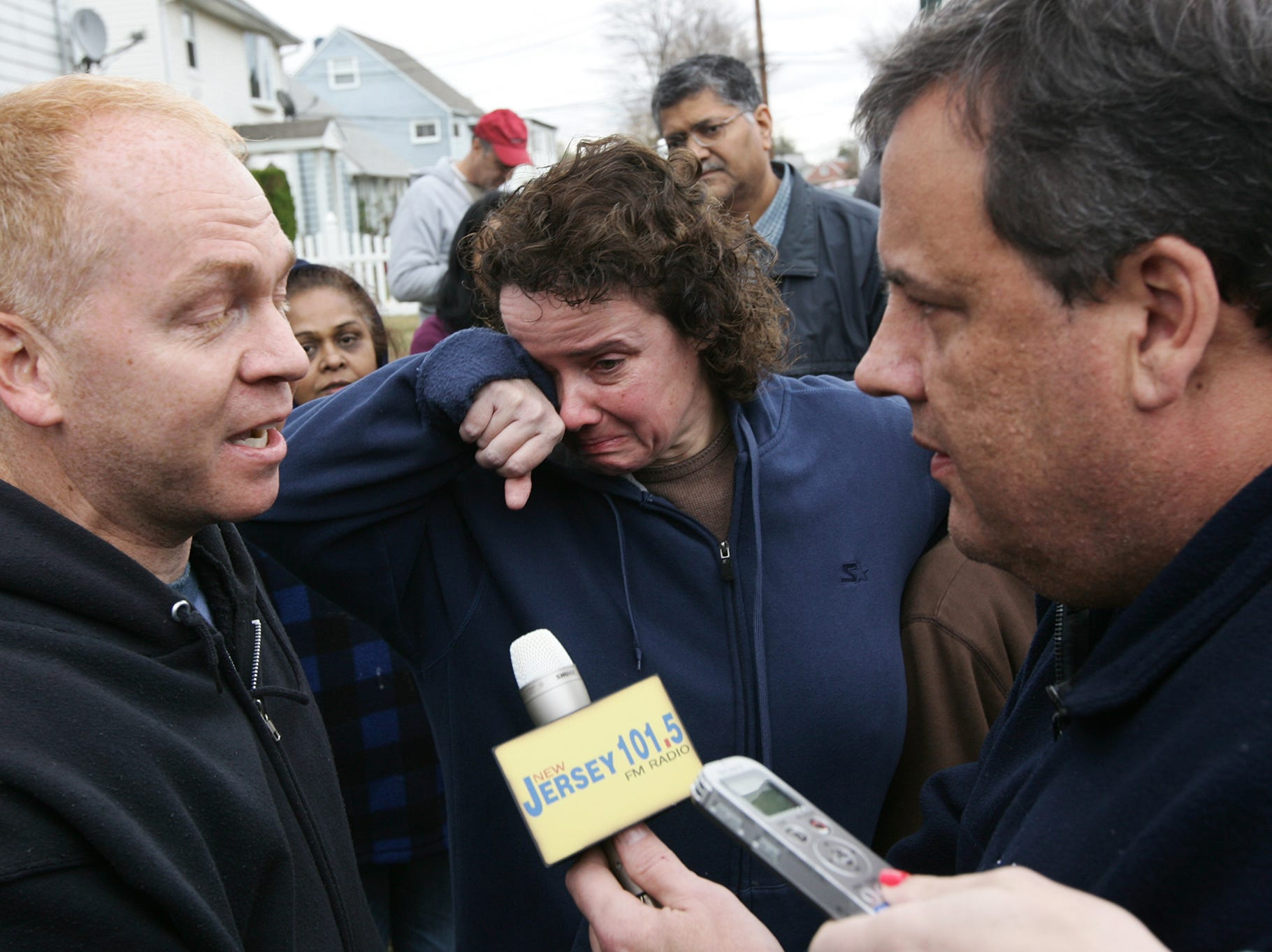 Annmarie Pansini (center) has had an emotional 72 hours after Hurricane Sandy swept through her Moonachie neighborhood.  Gov. Christie told her husband, Michael Pansini (left)and other residents that FEMA would get back to them within 24-48 hours of them calling to register. Thursday, November 1,