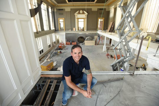 Chef Anthony Bucco on the mezzanine of his event space, still under construction, in Ridgewood.