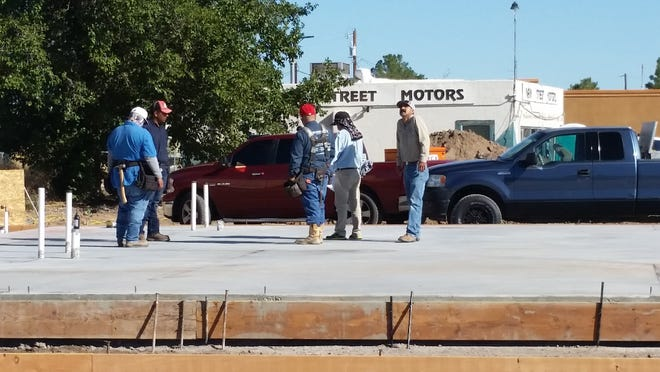 A crew works on Tuesday, Sept. 4, 2018,  to construct a new bank building at the site of the former Main Street Motors, 1043 N. Main St., Las Cruces. The building eventually will serve as a Bank of the Southwest location.