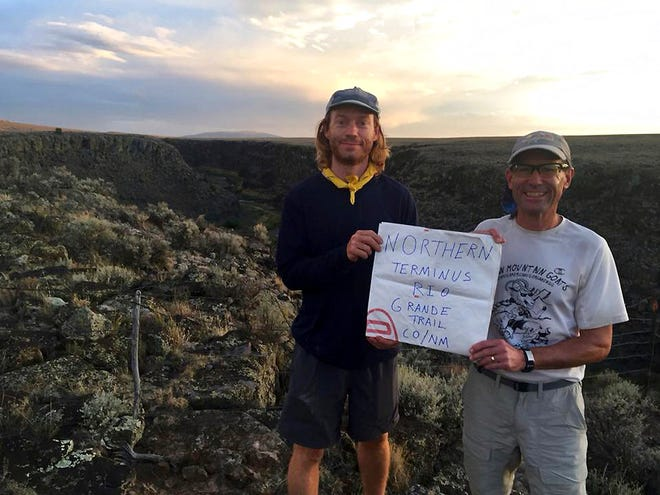 In this Aug. 31, 2018, photo provided by the Southern New Mexico Trail Alliance, hikers Dan Carter, left, and Peter Livingstone pose for a photo near the New Mexico/Colorado border near Cuesta, N.M. Hikers have embarked on a 500-mile expedition that will traverse New Mexico from end to end. The mission: Chart out the best route and identify what challenges might lay ahead as the state moves closer to establishing the Rio Grande Trail. Following in the footsteps of other states, New Mexico is looking to capitalize on its vistas, mild weather and culture with the creation of a long-distance trail along one of North America's longest rivers.