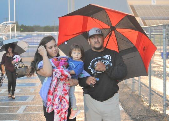 Carlsbad wrestling coach Ryan Salcido brings his wife SaVana and one-year old daughter JoAna to see the 2018 Carlsbad High powderpuff football game.